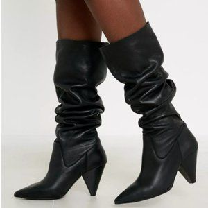 UO knee high slouchy leather boots